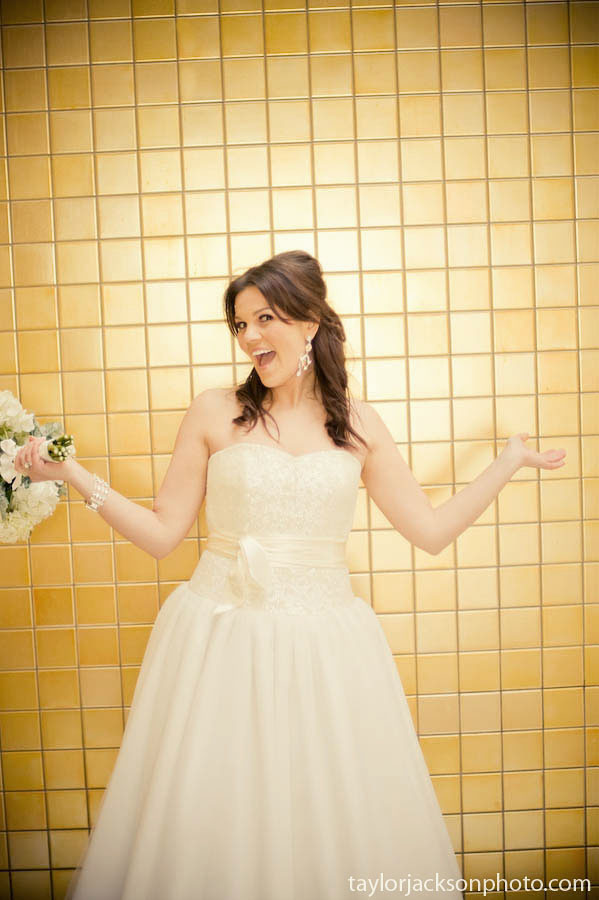 fun flowers infront of yellow wall bride