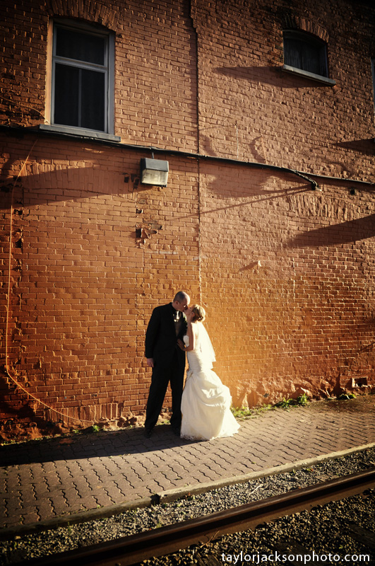 Orange wall in uptown waterloo bride and groom